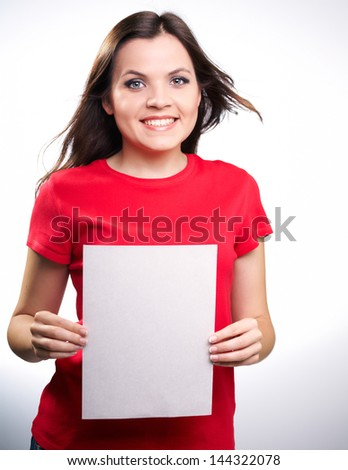 Attractive smiling girl in red shirt holding a poster,on white background.