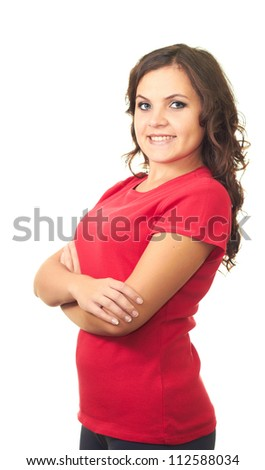 Attractive smiling girl in red shirt standing with hands folded. Isolated on white background