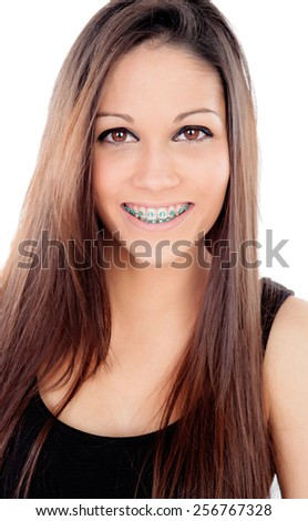 Attractive smiling girl with brackets isolated on a white background - stock photo