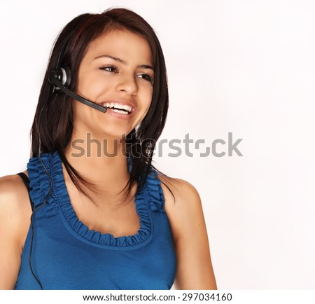 Attractive smiling kind young woman helping customer on phone  - stock photo