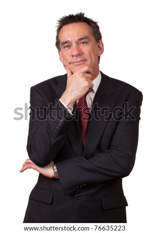 Attractive Smiling Middle Age Business Man in Suit with Hand to Face