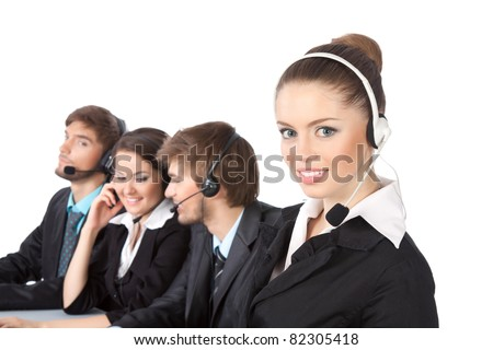 Attractive Smiling positive young businesswoman and colleagues in a call center office, support phone operators with headset at workplace over white background, agent friendly looking at camera