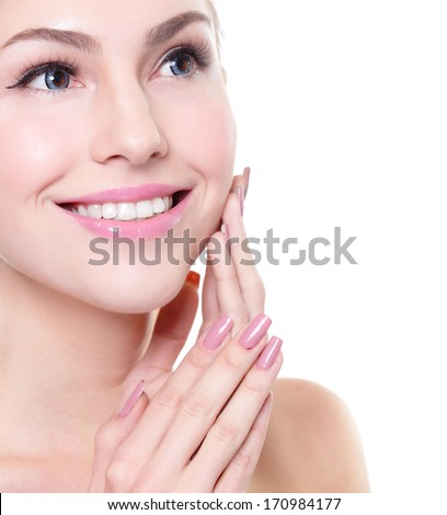 attractive smiling woman face with health teeth close up , copy space on the right side. Isolated over white background