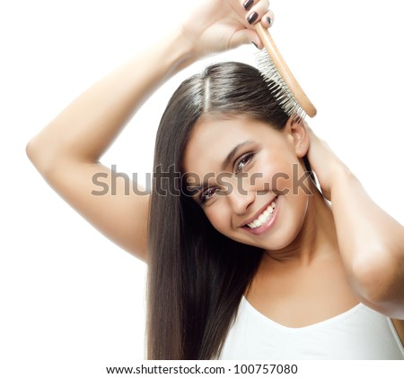 attractive smiling woman portrait on white background with comb - stock photo