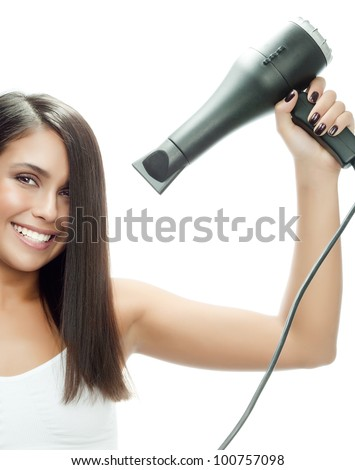 attractive smiling woman portrait on white background with hairdryer - stock photo