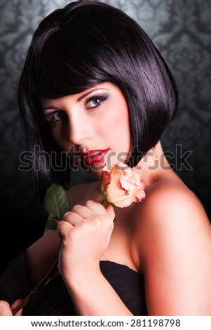 attractive smiling woman with a rose - stock photo