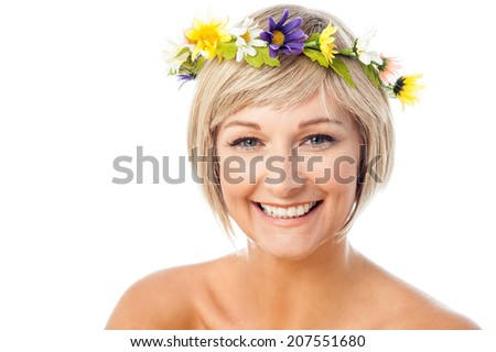 Attractive smiling woman with flower wreath on head - stock photo