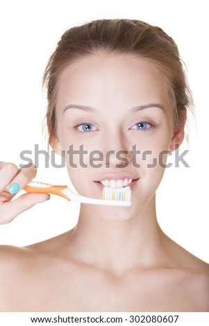 Attractive smiling young girl washing teeth on isolated white