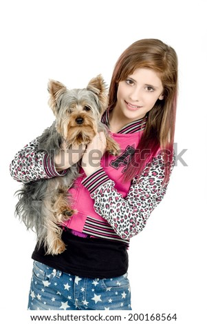 attractive smiling young girl with long hair wearing pink dress with her best friend yorkshire terrier isolated white background - stock photo