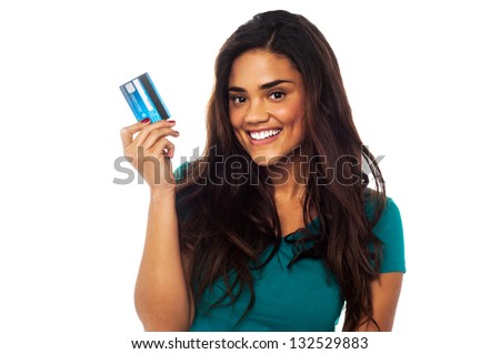 Attractive smiling young model holding up her credit card.