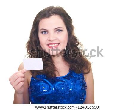 Attractive smiling young woman in a blue brilliant dress holding in her right hand poster. Isolated on white background