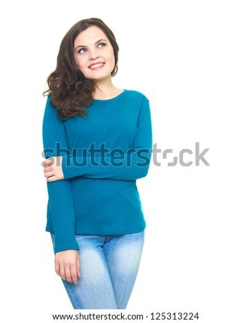 Attractive smiling young woman in a blue shirt looking up. Isolated on white background