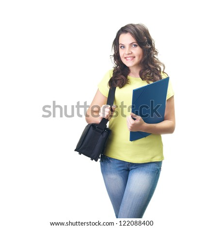 Attractive smiling young woman in a yellow shirt holding a blue folder and a black bag. Isolated on white background