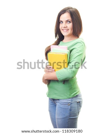 Attractive smiling young woman in green shirt holding a colorful book. Isolated on white background - stock photo