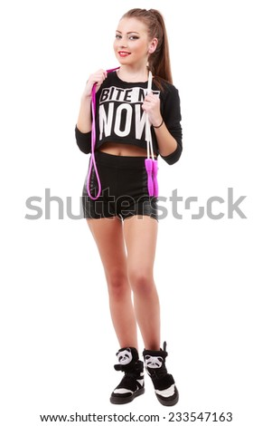Attractive sporty woman posing holding a skipping rope on white background