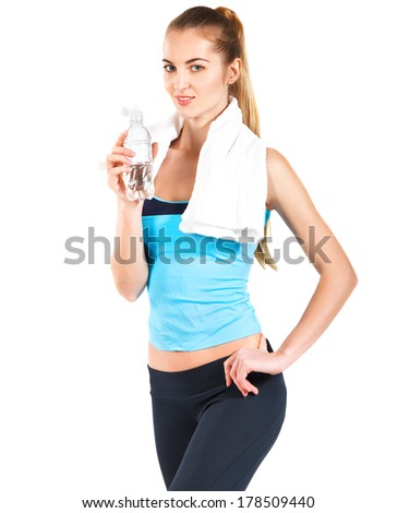 Attractive sporty woman with water and towel on white background