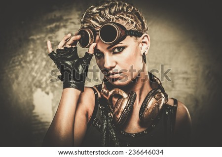Attractive steampunk girl wearing googles - stock photo