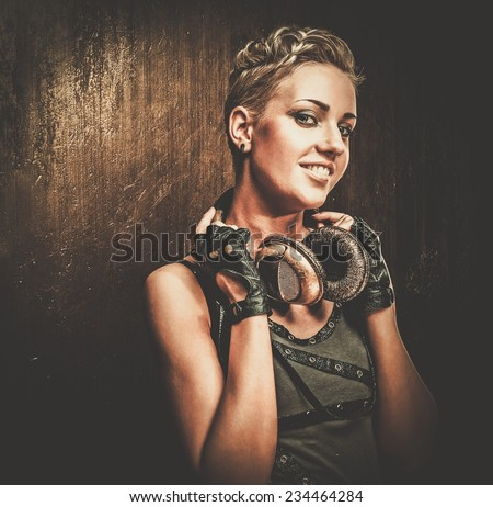 Attractive steampunk girl with headphones