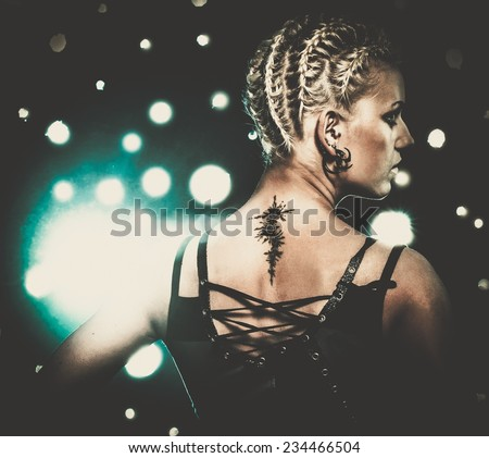 Attractive steampunk girl with tattoo - stock photo