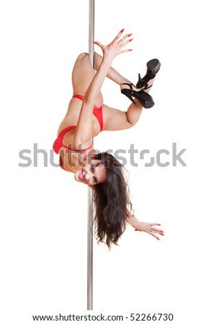 attractive stripper in red lingerie dancing on the pole. isolated on white