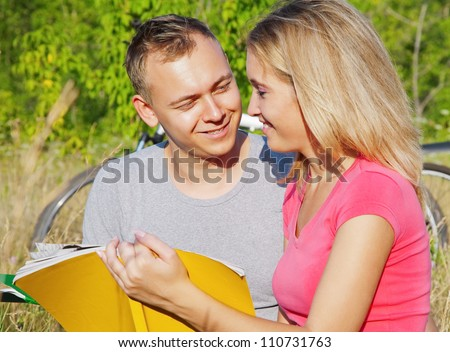 Attractive students looking at each other with love during studying