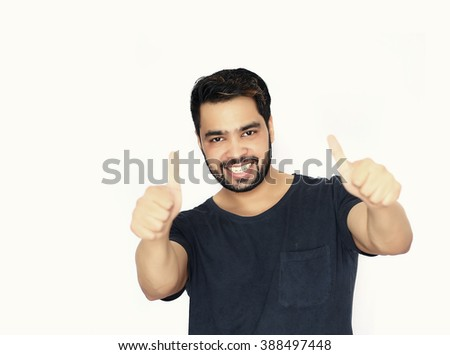 Attractive successful smiling man with thumb up. - stock photo
