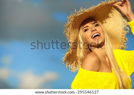 Attractive summer woman enjoying her time outside in park with blue sky  in background.