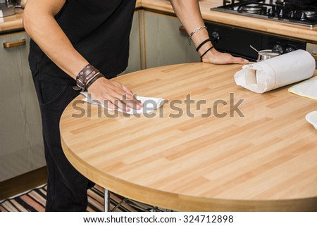 Attractive Surface of Kitchen Table with Paper Towel - Responsible Young Man Doing Chores in First Home