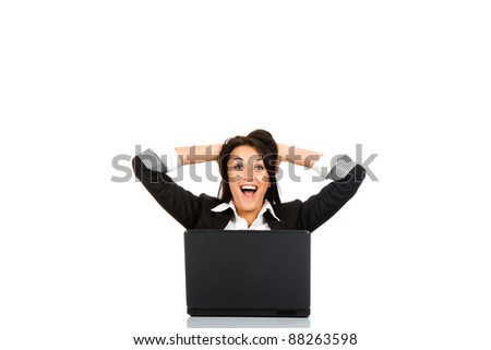 attractive surprised excited smile business woman hold hands on head sitting at the desk looking at camera, mouth open, isolated over white background, Winner businesswoman with success