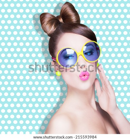 Attractive surprised young woman wearing sunglasses on dotted background, beauty and fashion concept  - stock photo