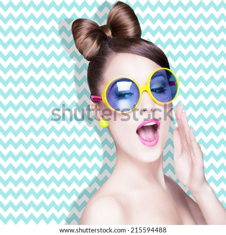 Attractive surprised young woman wearing sunglasses on zig zag background, beauty and fashion concept  - stock photo