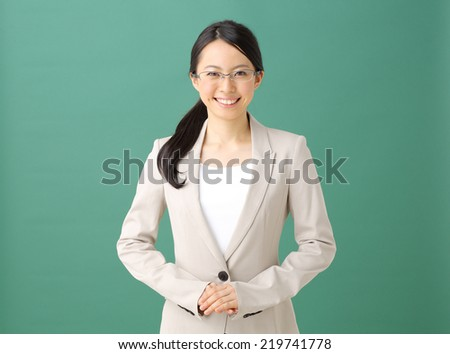 attractive teacher or student at the blackboard - stock photo
