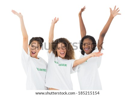 Attractive team of volunteers waving at camera on white background