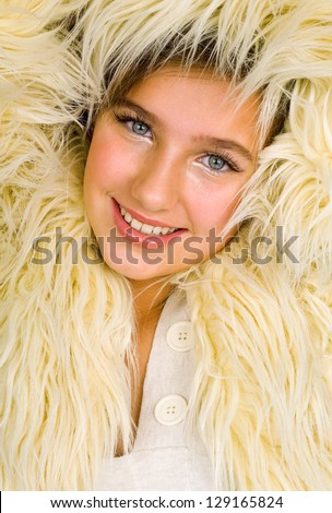 attractive teen girl in fur winter jacket