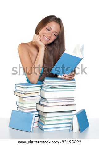 attractive teen girl reading the book - stock photo