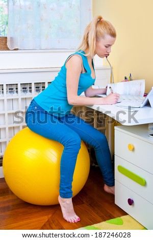 attractive teen girl  study at the desk in her room