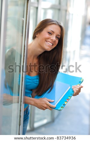 attractive teen girl with school books outside - stock photo