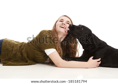 Attractive teen with her black lab puppy.  Isolated on white with room for your text. - stock photo