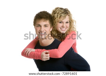 Attractive teenage couple, piggy back
