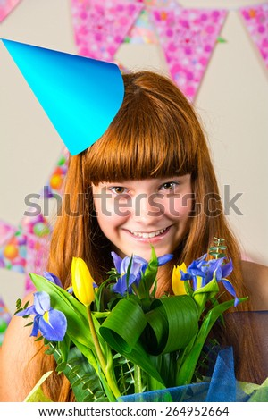 attractive teenage girl celebrating her birthday with flowers - stock photo