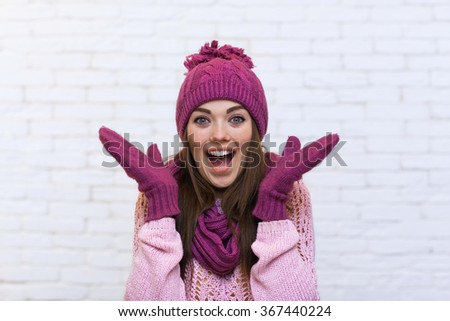 Attractive Teenage Girl Hand Gesture To Copy Space Cell Phone Call Smile Surprised Over White Brick Background - stock photo