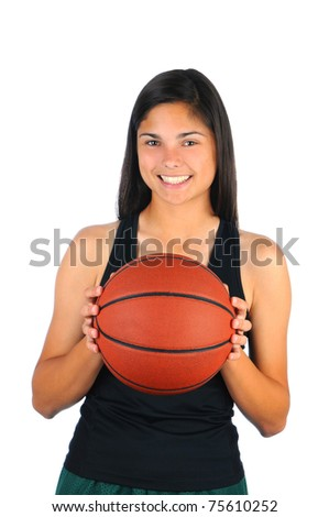 Attractive teenage girl holding a basketball in front of her body. Vertical format isolated over white.