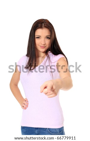 Attractive teenage girl in bad mood pointing with finger. All on white background. - stock photo