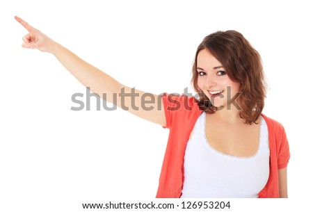 Attractive teenage girl points with finger. All on white background.
