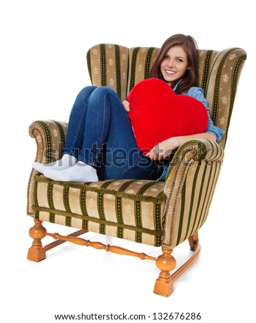 Attractive Teenage Girl Sitting In Retro Wing Chair. All On White  Background.