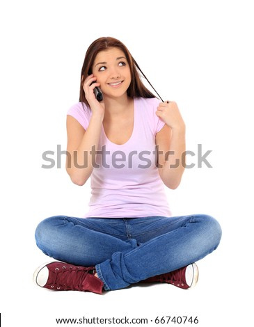 Attractive teenage girl talking on the phone. All on white background. - stock photo