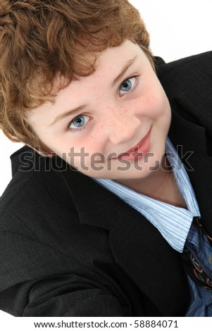 Attractive ten year old american boy in baggy blue suit over white background.