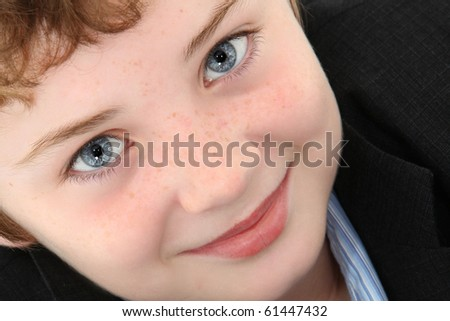 Attractive ten year old american boy over white background.