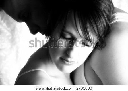 Attractive thirty something couple in embrace. - stock photo