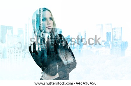 Attractive thoughtful businesswoman on New York city background. Double exposure - stock photo